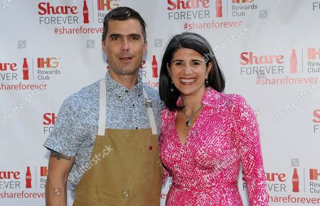 Chef Hugh Acheson, left, and Lara Hernandez, Vice President, Digital, Loyalty, and Partner Marketing, IHG, stand on the red carpet at the IHG Rewards Club Share Forever exclusive member event at Empire State South restaurant, in Atlanta