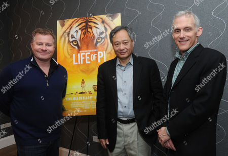 Academy Award winning director Ang Lee, center, screenwriter David Magee, left, and film editor Tim Squyres meet with media for the first time since their movie Life of Pi won four Academy Awards, including Best Director for Ang Lee, in New York, on behalf of the Blu-ray 3D, Blu-ray and DVD release on March 12