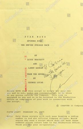 The inside page of Carrie Fisher's bound script for the Empire Strikes Back as signed by George Lucas with 'To Carrie may the force be with you'.