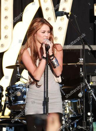 Los Angeles Ca - April 28: Singer Jordan Pruitt Performs at the World Wish Day Celebration with Miley Cyrus at the Grove On April 28 2010 in Los Angeles California People: Miley Cyrus