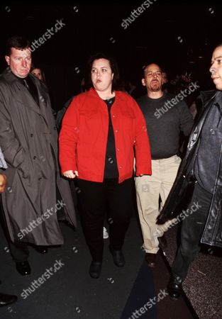 Stock Image of Rosie O'donnell and Bodyguards Tribute to Madeline Kahn Carolines On Broadway Nyc 2 / 25 / 02 Â