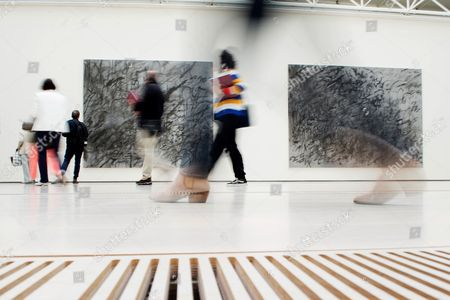 Visitors are seen at the exhibition Ethiopian artist Julie Mehretu 'Julie Mehretu. A Universal Story of all and Nothing' at the Botin Center in Santander, northern Spain, 11 October 2017.