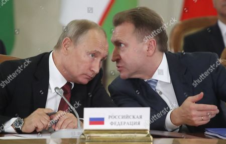 Russian President Vladimir Putin (L) and Russian First Deputy Prime Minister Igor Shuvalov (R) speak during a session of the Council of Heads of the Commonwealth of Independent States (CIS) in the Black sea resort of Sochi, Russia, 11 October 2017. CIS leaders meet in Sochi to discuss cooperation within the Commonwealth.