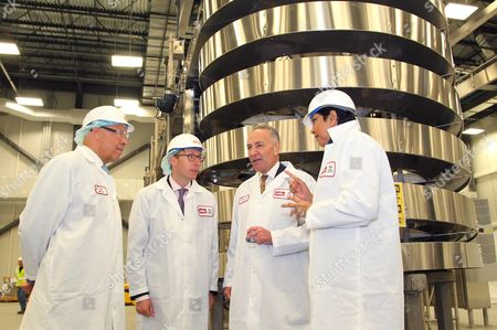 From left, Theo Muller, owner Theo Muller Group; Stefan Muller, board member Muller Quaker Dairy; United States Senator Charles E. Schumer and PepsiCo Chairman and Chief Executive Officer Indra Nooyi tour the Muller Quaker Dairy facility during the grand opening celebration on in Batavia, N.Y