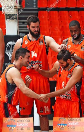 Valencia Basket players Spanish shooting guard Rafa Martinez (L) and French point guard Antoine Diot (2-R) joke next to Montenegrin center Bojan Dubljevic (C-L) and US power forward Will Thomas (R) after a press conference in Valencia, eastern Spain, 11 October 2017. Valencia Basket will play against Khimki this season's first Euroleague game on 12 October.