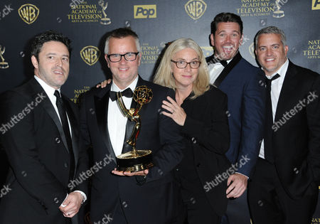 Andy Lassner, from left, Mary Connelly, Ed Glavin, Jonathan Norman, and Kevin Leman from The Ellen DeGeneres Show pose in the pressroom with the award for outstanding entertainment talk show at the 42nd annual Daytime Emmy Awards at Warner Bros. Studios, in Burbank, Calif