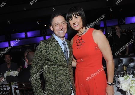 IMAGE DISTRIBUTED FOR BENJAMIN MOORE - Home furnishings designer Jonathan Adler congratulates fashion designer Trina Turk at the 2014 Benjamin Moore HUE Awards on at the Highline Ballroom in New York