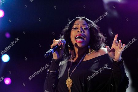 """Nicci Gilbert performs a tribute to Whitney Houston at the Essence Music Festival in New Orleans. TV reality show, """"R&B Divas,"""" which airs Mondays at 10 p.m. EDT has an episode that shows the women's tribute performance from the 2012 Essence Music Festival honoring Whitney Houston, Etta James and others"""