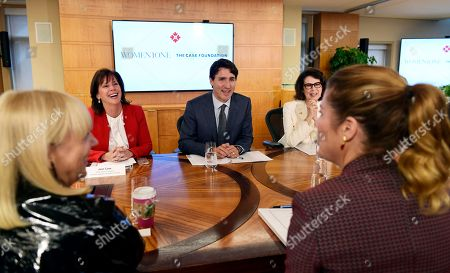 Justin Trudeau, Jean Case, Dayle Haddon, Gregoire Trudeau. Canadian Prime Minister Justin Trudeau, center, flanked by Jean Case, second from left, Chief Executive Officer of the Case Foundation, and Dayle Haddon, second from right, founder and Chief Executive Officer of WomenOne, speaks about his wife Gregoire Trudeau, right, during a roundtable discussion of WomenOne held at the Case Foundation in Washington