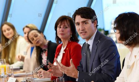 Justin Trudeau, Jean Case, Dayle Haddon. Canadian Prime Minister Justin Trudeau, second from right, flanked by Jean Case, third from right, Chief Executive Officer of the Case Foundation, and Dayle Haddon, right, founder and Chief Executive Officer of WomenOne, speaks during a roundtable discussion of WomenOne held at the Case Foundation in Washington