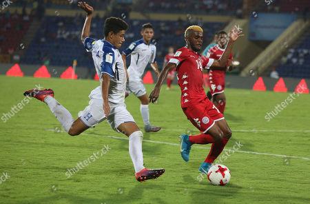 Honduras' Santiago Cabrera, 2, and New Caledonia's Bernard Iwa,14, vie for the ball during the FIFA U-17 World Cup match in Gauhati, India, Wednesday, Oct.11, 2017