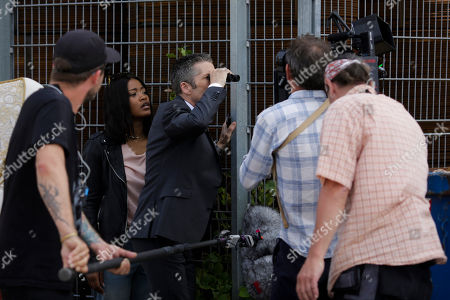 """On, actors Keke Palmer, second from left, and Leland Orser, center, perform at the set for an episode of Epix's """"Berlin Station"""" TV series in Berlin"""