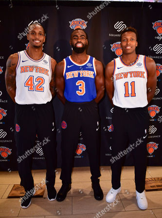 New York Knicks players Lance Thomas, Tim Hardaway Jr. and Frank Ntilikina pose with Squarespace sponsored jersey's at Madison Square Garden