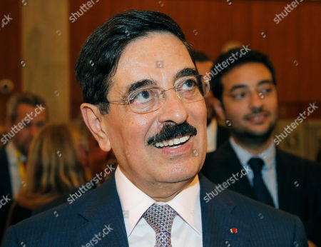 Hamad bin Abdulaziz al-Kawari, Qatar's candidate for the election of the United Nations Educational Scientific and Cultural Organization new leader, smiles at UNESCO headquarters in Paris, France, . UNESCO's executive board is choosing a new leader to replace departing director Irina Bokova, whose tenure was marred by funding troubles and tension over its inclusion of Palestine as a member