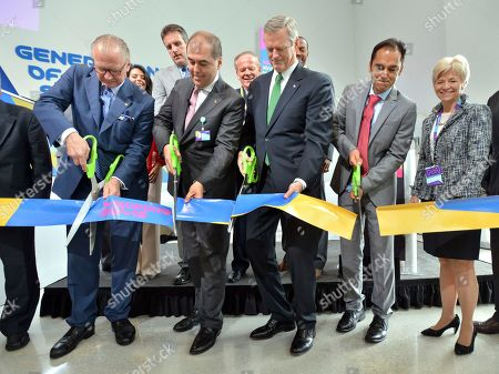 From left: Stefan Oschmann, Chairman of the Executive Board and CEO of Merck KGaA, Darmstadt, Germany, Johannes Baillou, Chairman of the Board of Partners of E. Merck KGaA, Darmstadt, Germany, Governor Charlie Baker, Udit Batra, CEO, MilliporeSigma, the life science business of Merck KGaA, Darmstadt, Germany, Sandra L. Fenwick, President and Chief Executive Officer of Boston Children's Hospital. The group cuts the ribbon at the ceremonial opening of MilliporeSigma's new life science center, in Burlington, Mass