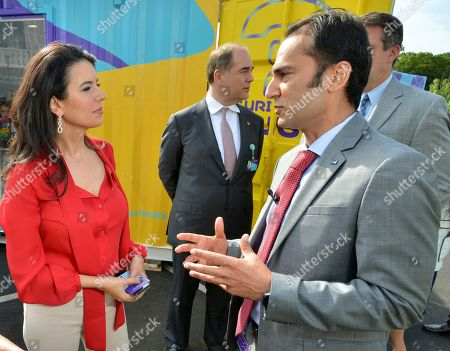 From Left: Linda Henry, Managing Director of the Boston Globe and Co-founder of HUBweek and Udit Batra, CEO, MilliporeSigma. They discuss the importance of STEM education outside of the Curiosity Cube?, MilliporeSigma's mobile science lab, in Burlington, Mass