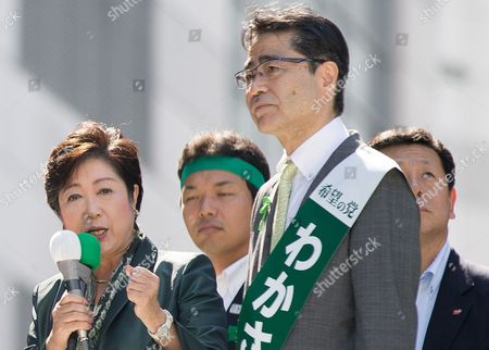 Tokyo Governor Yuriko Koike (L) gives a speech next to fellow party candidate Masaru Wakasa (R) during a rally at Tokyo's Ikebukuro district as she kicks off her campaign as the leader of newly-formed Party of Hope for her candidate running in the October 22 Japan general election on Tuesday, October 17, 2017.