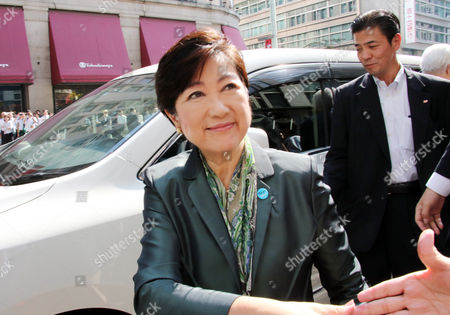 Tokyo Governor and leder of the Party of Hope Yuriko Koike shakes hands with  supporter upon her arrival for a campaign speech for her party candidate Taro Hatoyama (C) during a general election campaign in Tokyo on Tuesday, October 10, 2017.