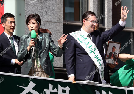 Tokyo Governor and leder of the Party of Hope Yuriko Koike (L) delivers a campaign speech for her party candidate Taro Hatoyama (R) during a general election campaign in Tokyo on Tuesday, October 10, 2017.