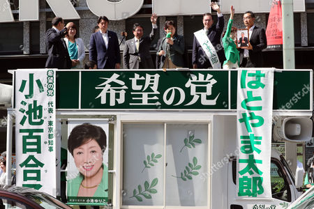 Tokyo Governor and leder of the Party of Hope Yuriko Koike (C) delivers a campaign speech for her party candidate Taro Hatoyama (2nd R) during a general election campaign in Tokyo on Tuesday, October 10, 2017.