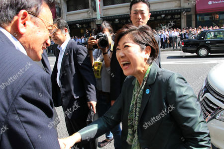 Tokyo Governor and leder of the Party of Hope Yuriko Koike shakes hands with her supporter upon her arrival for her party candidate Taro Hatoyama (C) during a general election campaign in Tokyo on Tuesday, October 10, 2017.