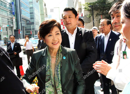 Tokyo Governor and leder of the Party of Hope Yuriko Koike shakes hands with her suporter upon her arrival for a campaign speech for her party candidate Taro Hatoyama (C) during a general election campaign in Tokyo on Tuesday, October 10, 2017.