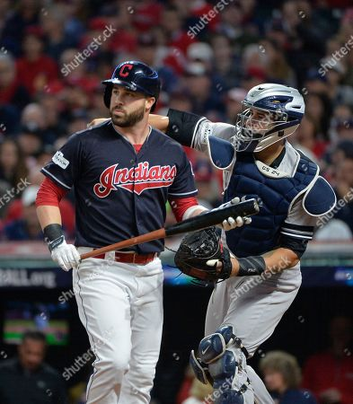 Jason Kipnis, Gary Sanchez. Cleveland Indians' Jason Kipnis walks back to the dugout after striking out against New York Yankees starting pitcher CC Sabathia during the first inning of Game 5 of baseball's American League Division Series, in Cleveland. Yankees catcher Gary Sanchez throws the ball back to the mound in the background