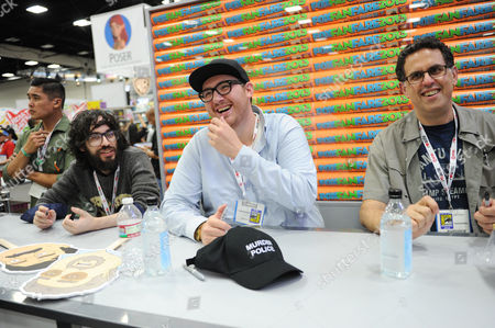 """From left, Jason Ruiz, Peter Atencio and David A. Goodman attend the FOX """"Murder Police"""" booth signing on Day 2 of Comic-Con International on in San Diego, Calif"""