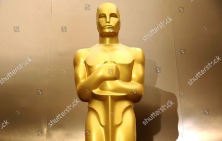 An Oscar statue stands on the red carpet as preparations are made for the 86th Academy Awards in Los Angeles. Oscar nominees in all 24 categories will hear their name announced live next week. Academy Awards producers Craig Zadan and Neil Meron said, they are launching a new tradition of revealing all Oscar contenders in a live news conference