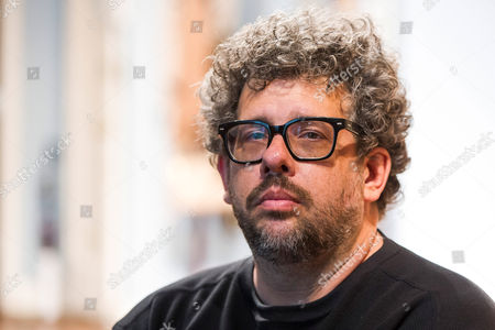 """FILE - In this photo, Neil LaBute poses on the set of his new play """"The Way We Get By"""" at the Second Stage Theatre in New York. A play festival benefiting the National Coalition Against Censorship will go on at a new location, but without the Neil LaBute play that led to the event being scrapped at its initial venue. Playwrights for a Cause said Tuesday that its festival featuring three new short plays about censorship in the arts will take place on June 14 at New York Theatre Workshop"""