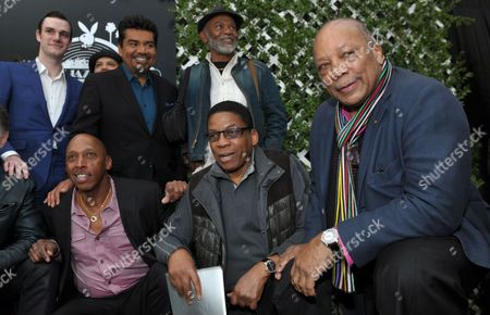 """Quincy Jones, right, poses with participants in this year's Playboy Jazz Festival, clockwise from top left, Playboy Enterprises founder Hugh Hefner's son Cooper, master of ceremonies George Lopez, and musicians Hubert Laws, Herbie Hancock and Jeffrey Osborne, following a news conference at the Playboy Mansion in Los Angeles. The new book """"Playboy Swings"""" releasing on Sept. 14, 2015, details Hugh Hefner's contribution to popularizing jazz and his stand against racial segregation in entertainment"""