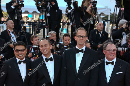 Co-director Ronnie Del Carmen, producer Jonas Rivera, director Pete Docter and chief creative officer at Pixar John Lasseter pose for photographers upon arrival at the screening of the film Inside Out at the 68th international film festival, Cannes, southern France