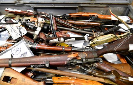 Confiscated firearms are put on display for the media in Brisbane, Queensland, Australia, 12 October 2017. Queensland Minister for Police, Fire and Emergency Services Mark Ryan announced that Queenslanders have handed in over 16,000 firearms as part of the national gun amnesty.
