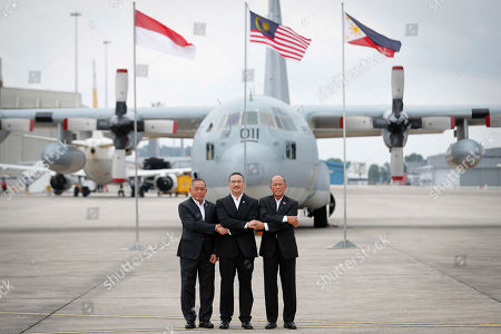Ryamizard Ryacudu, Hishammuddin Hussein, Delfin Lorenzana. From left to right, Indonesia's Defense Minister Ryamizard Ryacudu, Malaysia's Defense Minister Hishammuddin Hussein and Philippines' Defense Secretary Delfin Lorenzana join their hand for a group photo after the launch of the countries' joint air patrols at Subang military airbase in Petaling Jaya, Malaysia, . The Trilateral Air Patrol aims at improving safety and security mainly in the Sulu Sea