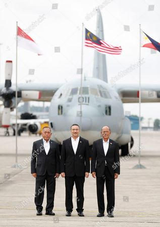 Ryamizard Ryacudu, Hishammuddin Hussein, Delfin Lorenzana. From left to right, Indonesia's Defense Minister Ryamizard Ryacudu, Malaysia's Defense Minister Hishammuddin Hussein and Philippines' Defense Secretary Delfin Lorenzana pose for a group photo after the launch of the countries' joint air patrols at Subang military airbase in Petaling Jaya, Malaysia, . The Trilateral Air Patrol aims at improving safety and security mainly in the Sulu Sea