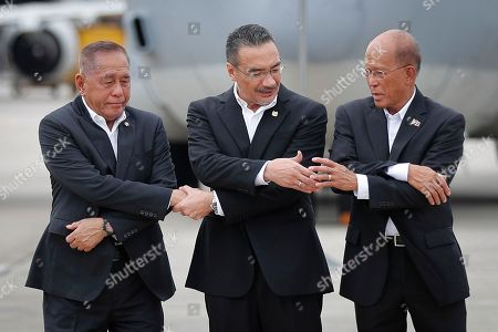 Ryamizard Ryacudu, Hishammuddin Hussein, Delfin Lorenzana. From left to right, Indonesia's Defense Minister Ryamizard Ryacudu, Malaysia's Defense Minister Hishammuddin Hussein and Philippines' Defense Secretary Delfin Lorenzana join their hands for a group photo after the launch of the countries' joint air patrols at Subang military airbase in Petaling Jaya, Malaysia, . The Trilateral Air Patrol aims at improving safety and security mainly in the Sulu Sea