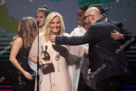 Stock Picture of Karen Peck accepts the award for Southern Gospel Artist of the Year at the 47th Annual GMA Dove Awards at Lipscomb University, in Nashville, Tenn