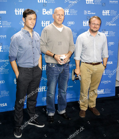"""Actors Joseph Gordon-Levitt, left, and Bruce Willis pose with writer-director Rian Johnson during a photo call and press conference for the film """"Looper"""" during the 2012 Toronto International Film Festival at the TIFF Bell Lightbox on in Toronto"""