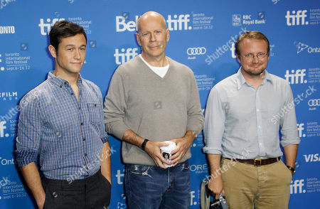 """Actors Joseph Gordon-Levitt, left, Bruce Willis, center, and writer-director Rian Johnson pose during a photo call and press conference for the film """"Looper"""" during the 2012 Toronto International Film Festival at the TIFF Bell Lightbox on in Toronto"""
