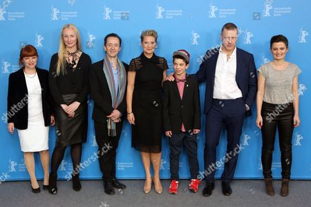 From left, producers Vinca Wiedemann, Sisse Graum Joergensen, sreenwriter Kim Fupz Aakeson, actors Trine Dyrholm, Sofus Ronnov, Mikael Persbrandt and director Pernille Fischer Christensen attend the photo call for the film Someone You Love during the 64th Berlinale International Film Festival, in Berlin
