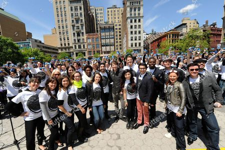 Singer-songwriter Owl City (A.K.A. Adam Young), center in black shirt, joins 500 a cappella singers, including famed vocal quintet Pentatonix, in New York's Union Square, for a group sing-a-long of the OREO Wonderfilled anthem to kick off the brand's new campaign