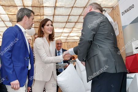 Stock Photo of Crown Prince Frederik Andre Henrik Christian and Crown Princess Mary Elizabeth Donaldson attend a Danish lifestyle and food exhibition at the Embassy of Denmark in Tokyo