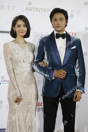 South Korean actress Yoon A (L) and actor Jang Dong-Gun (R), arrive  at the opening ceremony of the 22th Busan International Film Festival (BIFF) in Busan, South Korea, 12 October 2017. The BIFF runs from 12 to 21 October 2017, with 298 films from 75 countries to be screened.