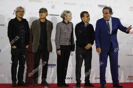(L-R) Filipino filmmaker Lavrente Diaz, South Korean director Jang Sun-Woo, French director Agnes Godard, Iranian director Bahman Ghobadi and US director William Oliver Stone, arrive at the opening ceremony of the 22th Busan International Film Festival (BIFF) in Busan, South Korea. 12 October 2017.The BIFF runs from 12 to 21 October 2017, with 298 films from 75 countries to be screened.