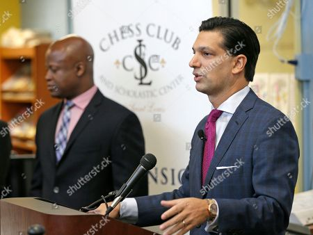Nick Ragone, Ascension's Chief Communications and Marketing Officer, speaks at a news conference to announce an initiative by Ascension and the St. Louis Chess club to start chess clubs in the schools of the Ferguson-Florissant school district as Grand Master Maurice Ashley looks, at Walnut Grove Elementary School in Ferguson, MO