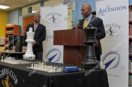 Dr. Joseph Davis, superintendent of the Ferguson-Florissant School District, speaks at a news conference to announce an initiative by Ascension and the St. Louis Chess club to start chess clubs in the schools of his district, as Grand Master Maurice Ashley, left, listens, at Walnut Grove Elementary School in Ferguson, MO