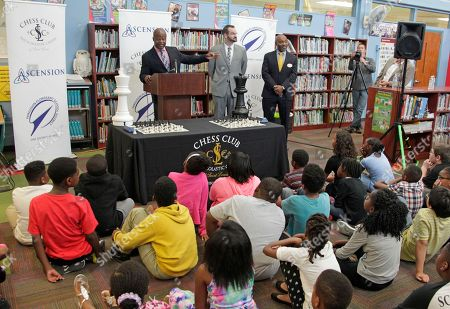 Chess Grand Master Maurice Ashley speaks to a group of students at a news conference to announce an initiative by Ascension and the St. Louis Chess club to start chess clubs in the schools of the Ferguson-Florissant school district, at Walnut Grove Elementary School in Ferguson, MO