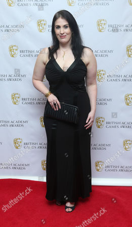 """Rhianna Pratchett, writer of Tomb Raider and Rise of the Tomb Raider,"""" arrives for the 2013 British Academy Games Awards at the Hilton hotel in central London. At the 2016 D.I.C.E. Summit which runs Feb. 16-18, 2016, the Academy of Interactive Arts and Sciences is kicking off its annual summit by unveiling an initiative to include more women in the video game industry. While about 44 percent of the gaming population is made up of women, only about 18 percent of game creators identify as female"""