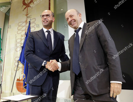 Italian Foreign Minister Angelino Alfano, left, meets Raffaele Jerusalmi, CEO of Borsa Italiana, at the stock market building, in Milan, Italy