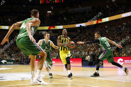 Unicaja's players Nemanja Nedovic (R) and Adam Waczynski (2-L) in action against Fenerbahce's James Nunnally (2-R) during the EuroLeague basketball match played between Unicaja Malaga and Fenerbahce Istanbul in Malaga, southern Spain, 12 October 2017.